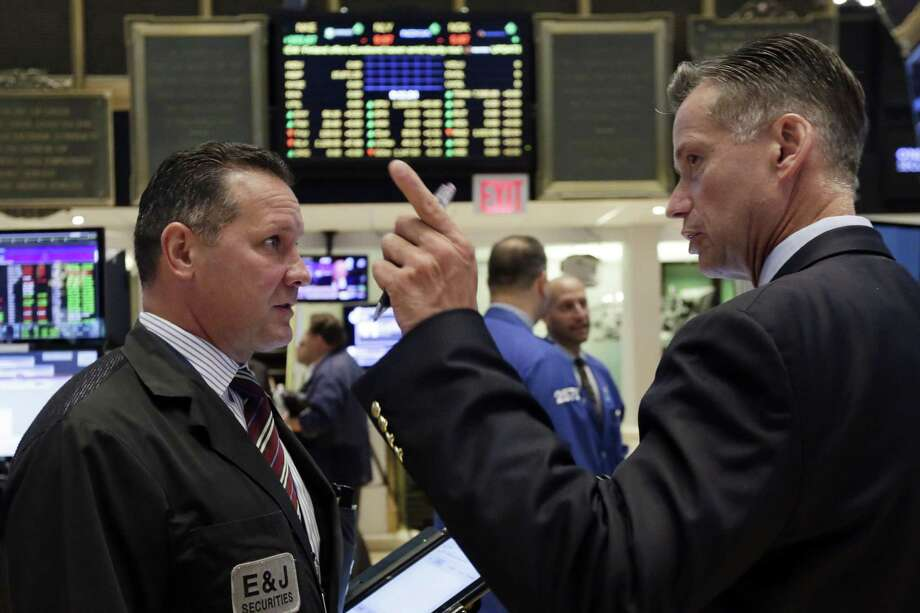 Traders Edward Curran, left, and Neil Catania work on the floor of the New York Stock Exchange, Tuesday, Aug. 25, 2015. U.S. stocks jumped at the open after China's central bank cut interest rates to support its economy. Photo: AP Photo/Richard Drew / AP