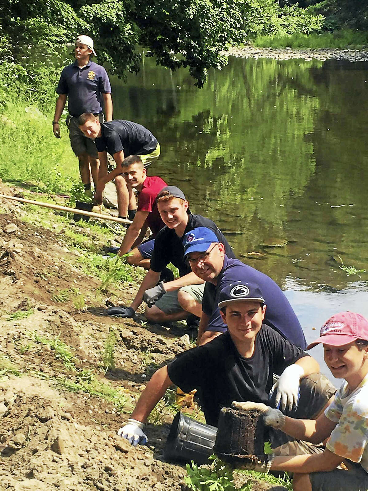 Contributed photos Gunnery students take part in Brendon Vejseli's Eagle Scout project on the Shepaug River.