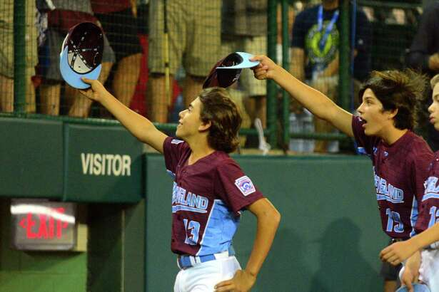 Fairfield American's Ethan Righter, left, and Christian Smith tip their ball caps to their families at the end of the road in Little League World Series action against Lufkin, TX at Lamade Stadium in South Williamsport, Penn., on Thursday Aug. 24, 2017.