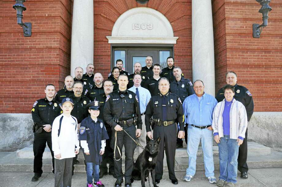 Contributed photo Members of the Torrington Police Department along with the Make-A-Wish Foundation planned a special day for Samantha Hall on Feb. 27. Torrington Police Officers picked up Samantha at her home and brought her to police headquarters, where she was given a tour of the facility, watched a K-9 demonstration and participated in processing evidence from a mock crime scene.  Samantha and her family were then escorted to Pizza Palace for a presentation made by the Make-A-Wish Foundation. Photo: Contributed Photo