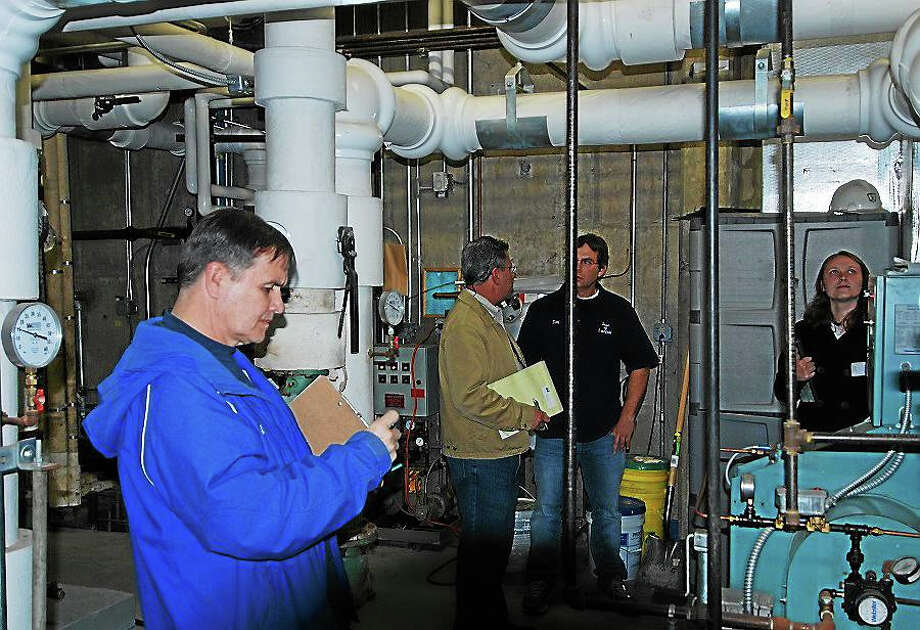ICF's Tom Quigley, Litchfield Facilities Manager Len Fasano, Litchfield School District Custodian Tim Wilcox and Eversource's Stephanie Rogers conduct the energy audit at Litchfield Intermediate School. Photo: Contributed Photo