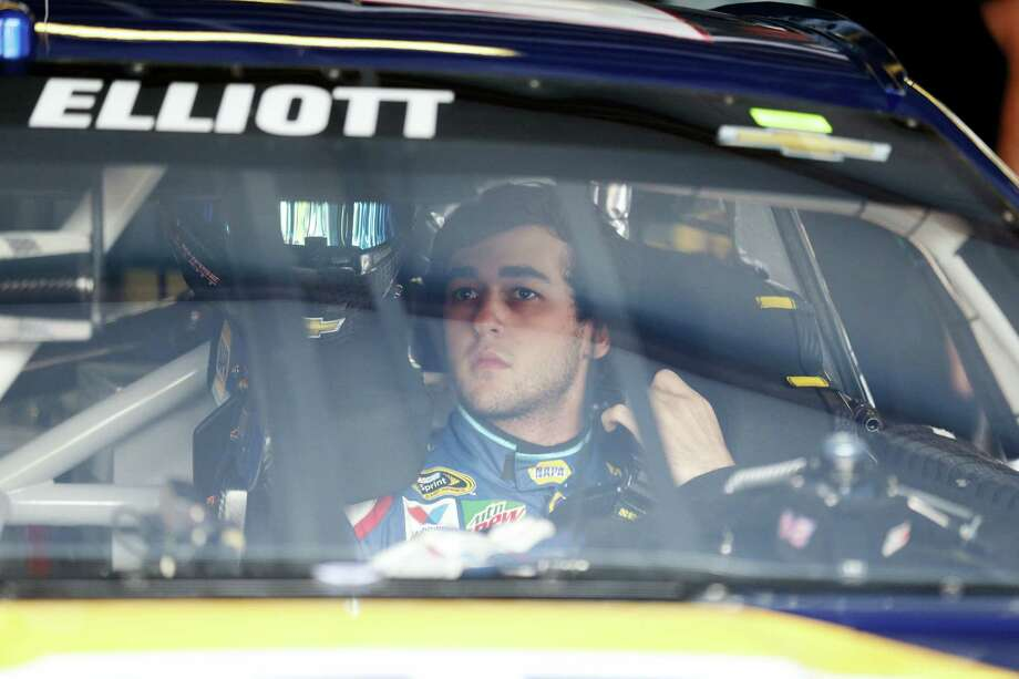 NASCAR driver Chase Elliott (24) adjusts his safety harness as he gets ready to practice for Sunday's race at Talladega Superspeedway. Photo: Brynn Anderson — The Associated Press  / Copyright 2016 The Associated Press. All rights reserved. This material may not be published, broadcast, rewritten or redistributed without permission.