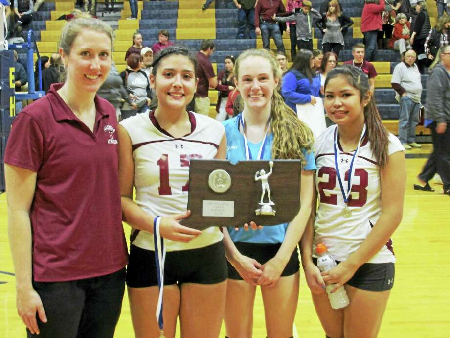 Photo by Peter WallaceTorrington's girls volleyball team is the Class M state championship runner-up. Left to right, Coach Christine Gamari and captains Jayleen Colon, Candyce Jewett and Gabby Ballesteros show off the proof. Photo: Digital First Media