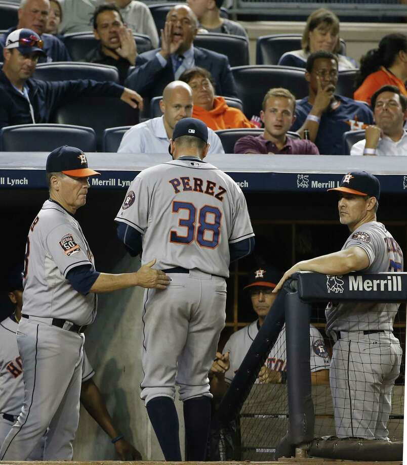 Houston Astros reliever Oliver Perez (38) leaves the field with bases loaded in the ninth inning of the Astros 1-0 loss to the New York Yankees in a baseball game at Yankee Stadium in New York, Monday, Aug. 24, 2015.  (AP Photo/Kathy Willens) Photo: AP / AP