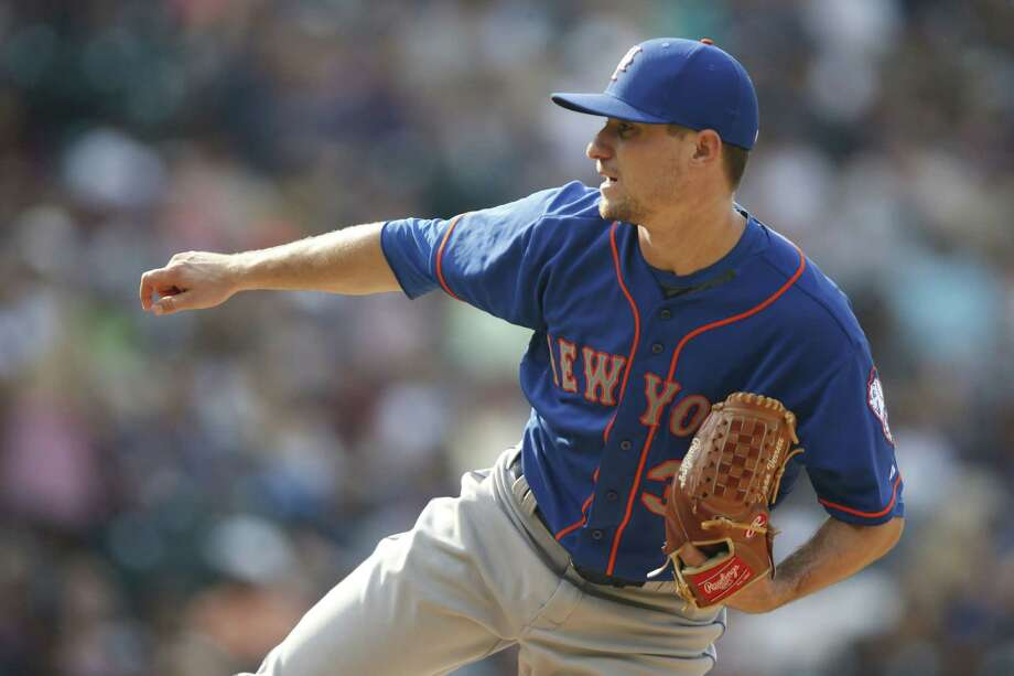 Mets starting pitcher Logan Verrett works against the Rockies in the eighth inning Sunday. Photo: David Zalubowski — The Associated Press  / AP