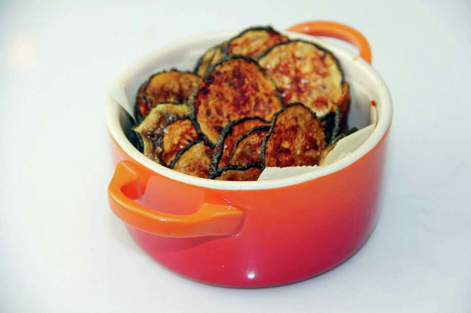 Baked BBQ zucchini chips have joined the growing list of healthy veggie snacks. Photo: Melissa D'Arabian — The Associated Press  / Melissa d'Arabian