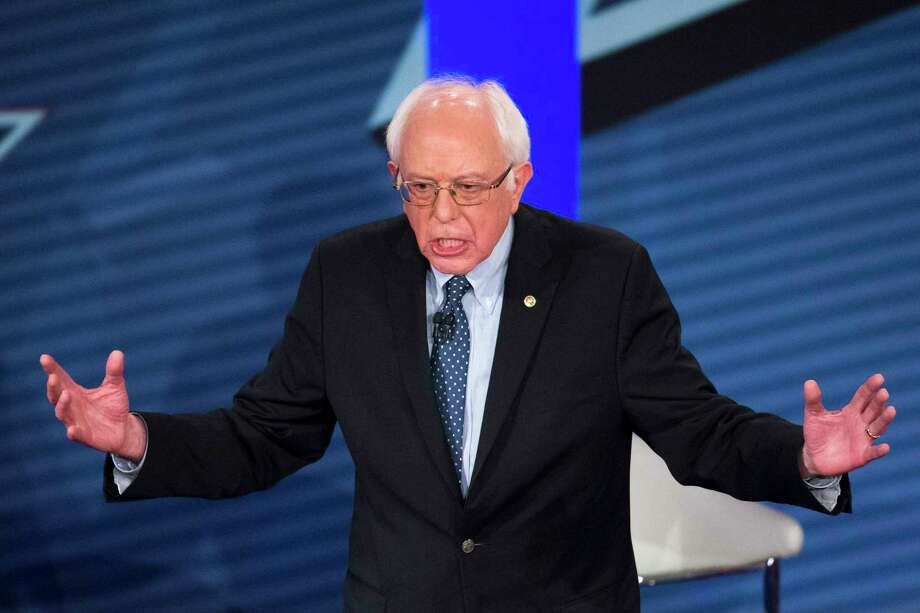 Democratic presidential candidate Sen. Bernie Sanders, I-Vt., answers a question from the audience during a Democratic primary town hall sponsored by CNN on Feb. 3, 2016 in Derry, N.H. Photo: AP Photo/John Minchillo  / AP