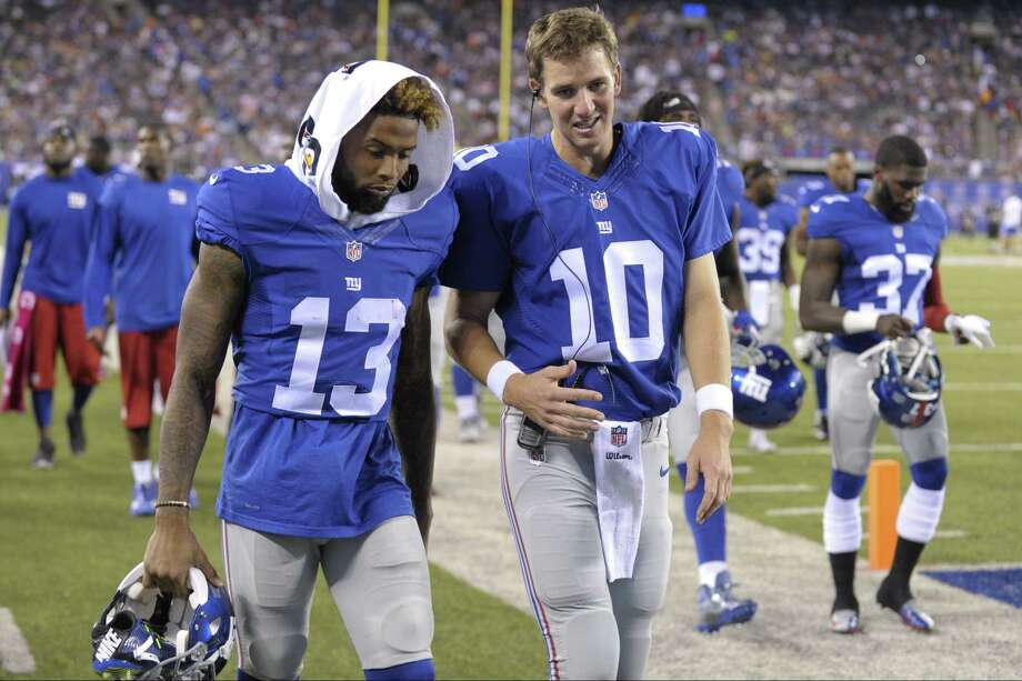Giants quarterback Eli Manning (10) and Odell Beckham talk while walking off the field after the first half Saturday. Photo: Bill Kostroun — The Associated Press  / FR51951 AP