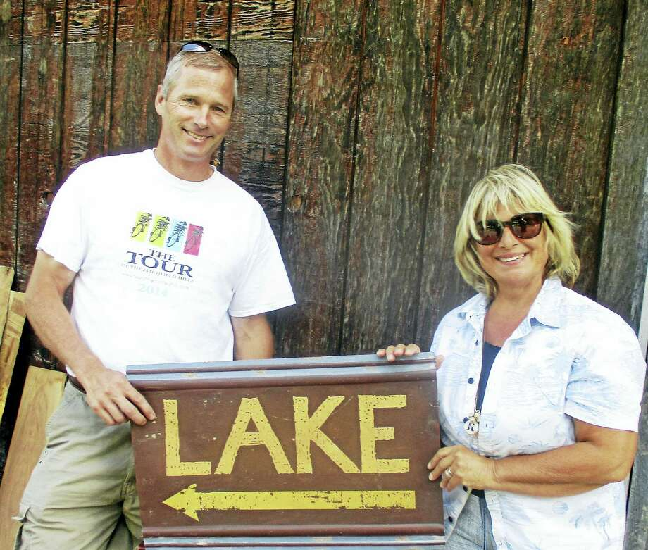 Photo by Jo Ann JaacksMorris First Selectman Tom Weik and Rose Buckens show their Lake Little Free Library lending stand during a recent building workshop at Harvey Hubbel's home in Litchfield. Photo: Journal Register Co.