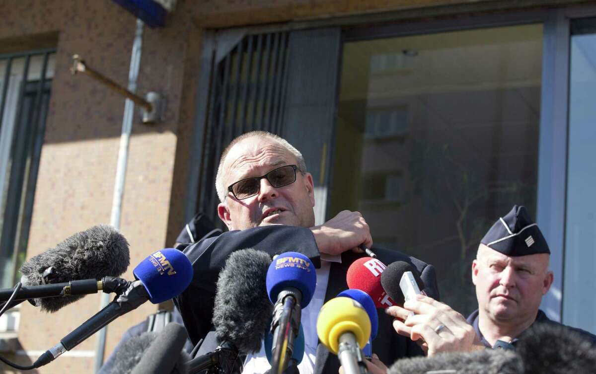 Britain's Chris Norman speaks with the media at the police headquarters in Arras, northern France, Saturday, Aug. 22, 2015. A gunman prepared to open fire with an automatic weapon on a high-speed train traveling from Amsterdam to Paris Friday, wounding several people before being subdued by passengers, officials said. Norman, along with two others, rushed the gunman and held him until police arrived.