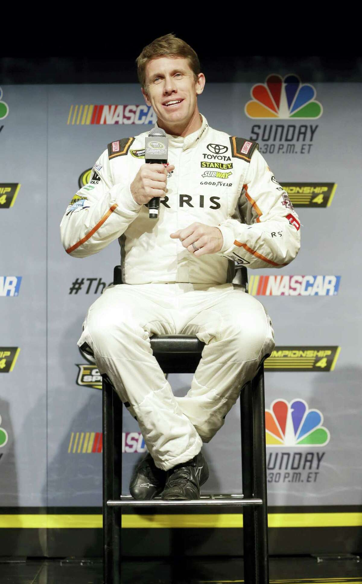 Carl Edwards answers a question during a news conference Thursday in Miami Beach, Fla.