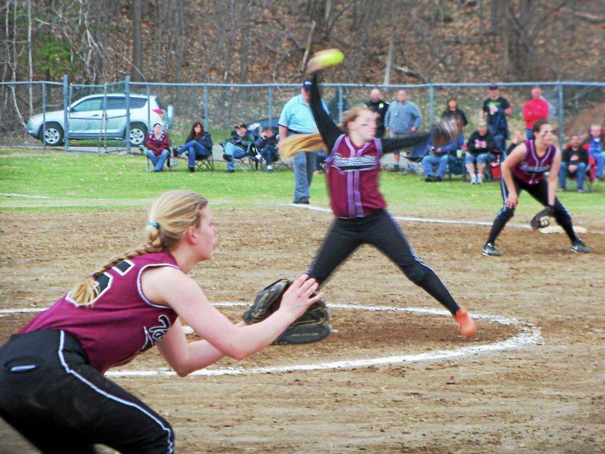 Peter Wallace - Register Citizen Torrington pitcher Ali Dubois whirls into motion against Kennedy Thursday between third baseman Brittany Anderson and first baseman C.C. Carbone.