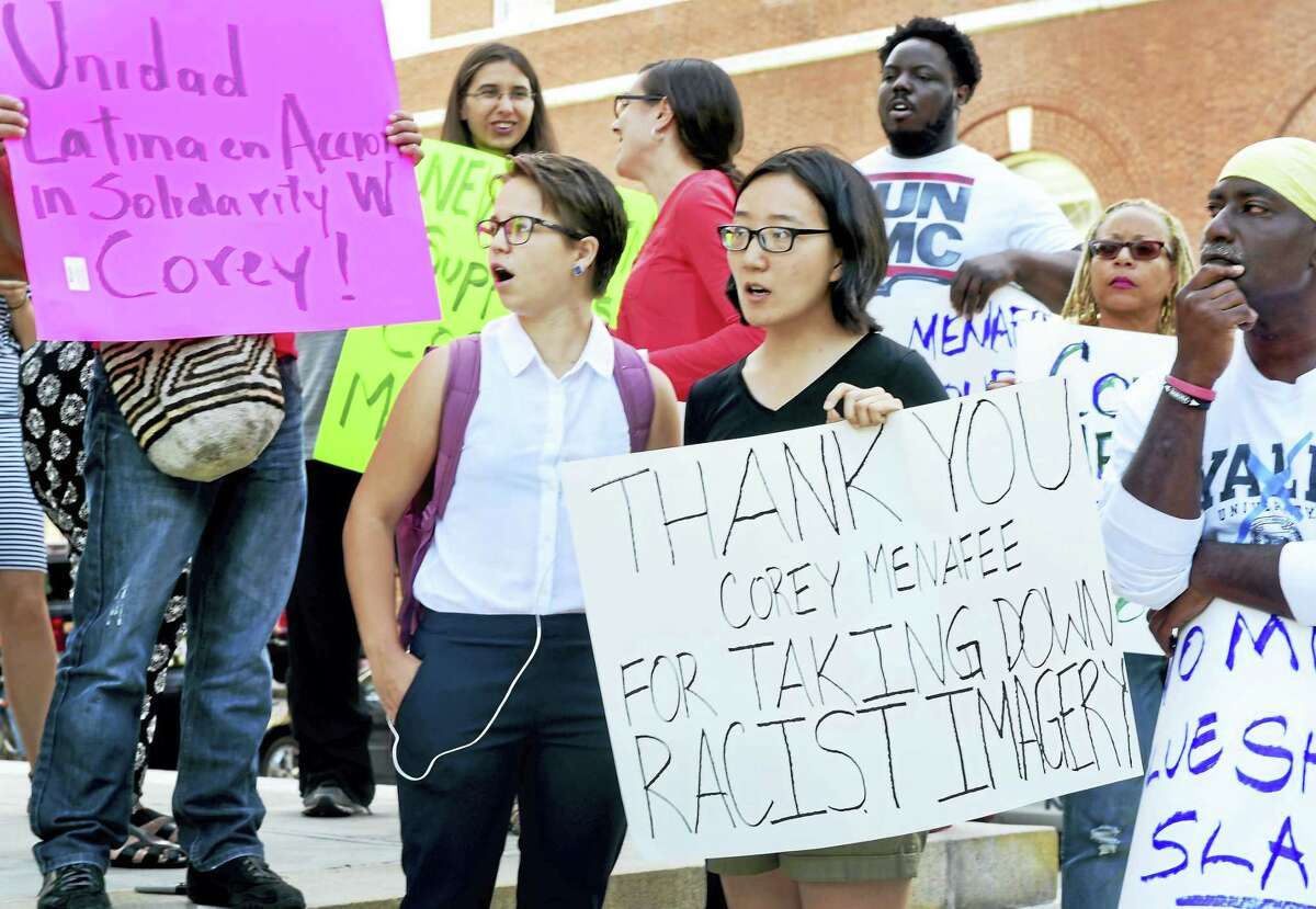 Linda Xing, a Yale University student at Calhoun College, center with sign, and others rally at Superior Court on Elm Street in New Haven Tuesday.