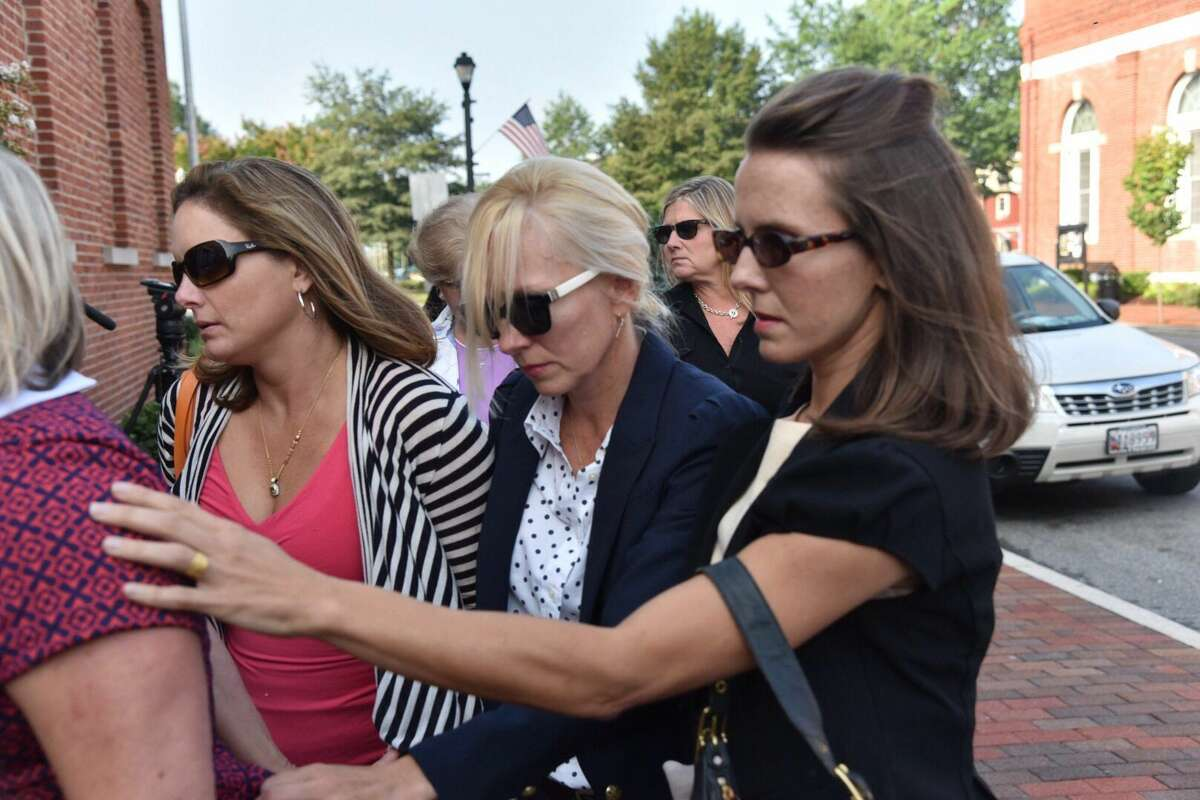 Molly Shattuck, second from right foreground, arrives at the Sussex County Courthouse in Georgetown, Del., for sentencing, Friday. The former Baltimore Ravens cheerleader was sentenced to two years of probation after pleading guilty to raping a 15-year-old boy at a vacation rental home in Delaware.