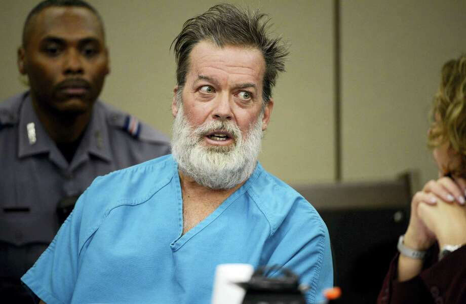 In this Dec. 9, 2015, file photo, Robert Lewis Dear, middle, talks during a court appearance in Colorado Springs, Colo. The man who acknowledges killing three people at a Colorado Planned Parenthood clinic will return to court for a discussion of his mental health. The Thursday, April 28, 2016, hearing will focus on whether 57-year-old Dear is competent to continue with his criminal case. Photo: Andy Cross/The Denver Post Via AP, Pool, File   / Pool Denver Post