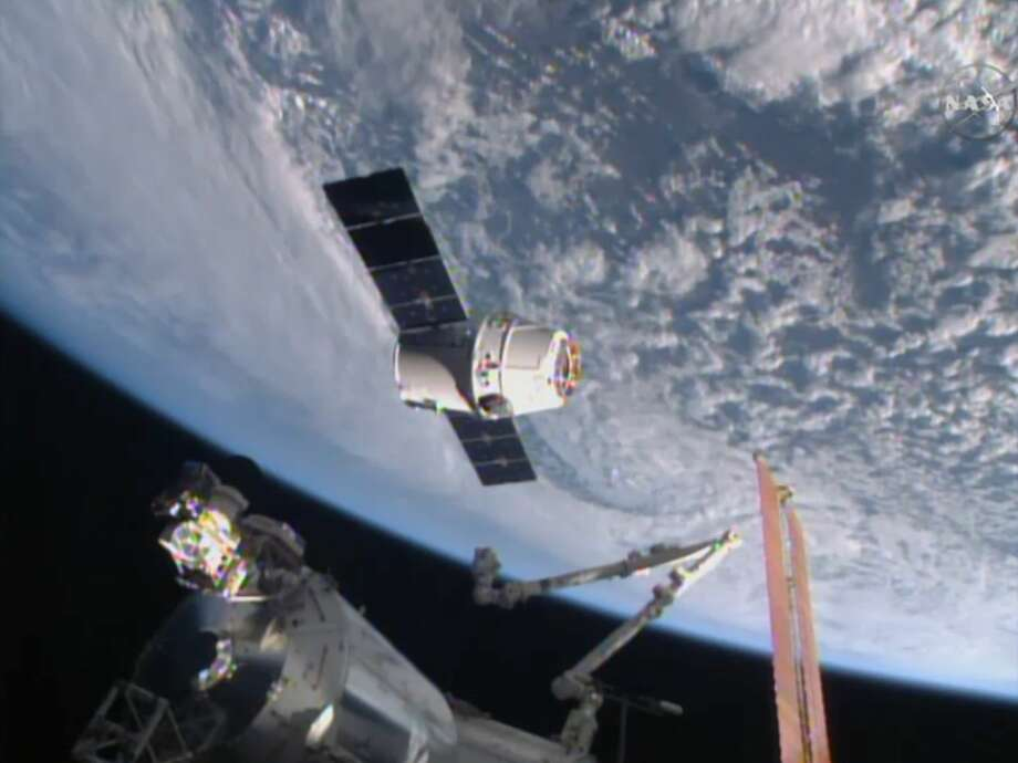 In this image from NASA-TV shows the SpaceX Dragon-6 resupply capsule Friday April 17, 2015 as it holds at the grapple point, 10 meters from the International Space Station as they cross over the Asia. (NASA-TV via AP) Photo: AP / NASA-TV