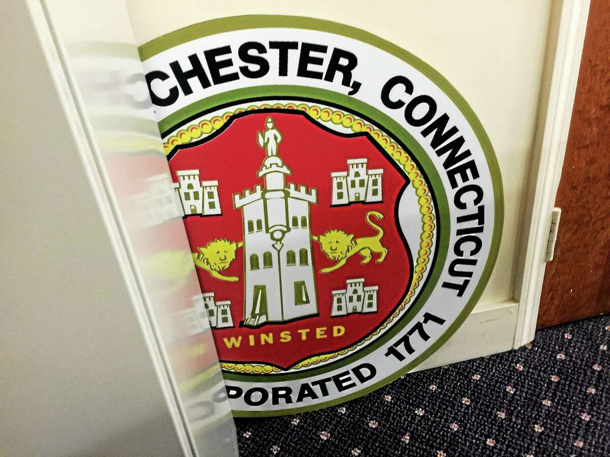 A physical representation of the Winsted/Winchester Town Seal, slightly obscured, in Town Hall.