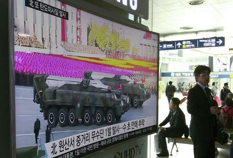 "A man walks by a TV news program showing a file footage of North Korean missiles paraded at a military parade in Pyongyang, at Seoul Railway Station in Seoul, South Korea, Thursday, April 28, 2016. A suspected powerful intermediate-range North Korean missile crashed moments after liftoff Thursday, South Korea's Defense Ministry said, in what would be the second such embarrassing failure in recent weeks. The letters on a screen read: ""North Korean launch of a Musudan missile appears to have failed."" Photo: AP Photo/Ahn Young-joon   / Copyright 2016 The Associated Press. All rights reserved. This material may not be published, broadcast, rewritten or redistributed without permission."