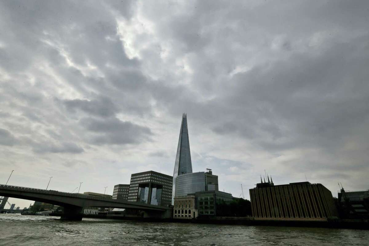 """In this Thursday, June 19, 2014, file photo, the Shard as seen from the river Thames in London. A new report says a drone just missed hitting an A320 passenger plane flying above the Shard skyscraper in central London in July. The """"very near-miss"""" underscored the fears of many aviation experts about the growing popularity of drones. The plane was approaching Heathrow Airport and flying at nearly 5,000 feet (1,525 meters) when the pilot spotted a 50-centimeter (20-inch) drone off the right flight deck window, it was reported on Thursday, Nov. 17, 2016."""