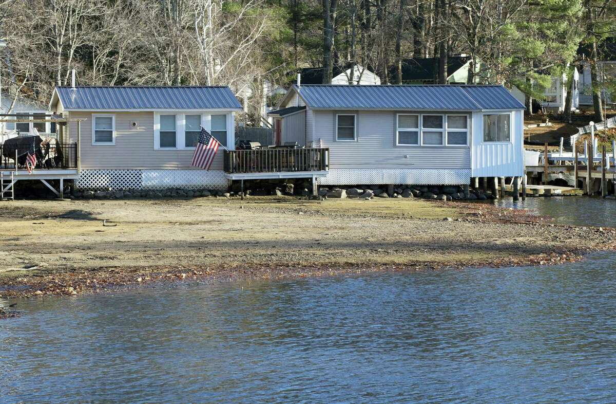 Waterfront cabins are seen on Lake Winnipesaukee Thursday, Nov. 17, 2016, in Laconia, N.H. The long-running drought in much of the Northeastern United States is expected to persist through the winter. The U.S. Drought Monitor map released Thursday shows dry conditions continuing through February throughout New England.