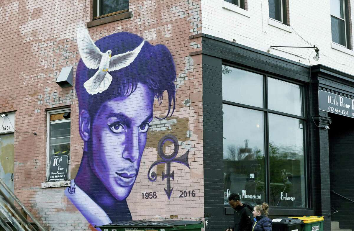 A mural honoring the late rock star Prince adorns a building in the Uptown area of Minneapolis Thursday, April 28, 2016, Prince died last week at his Paisley Park home at the age of 57. An investigation into his death continues.