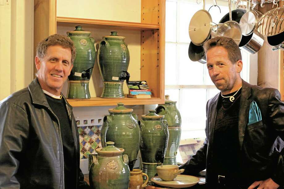 Todd Piker, left, of Cornwall Bridge Pottery, and Leslie Gabrielof WaterCheck.biz have teamed up to present Terra Water Pottery. Photo: John Fitts — THe Register Citizen