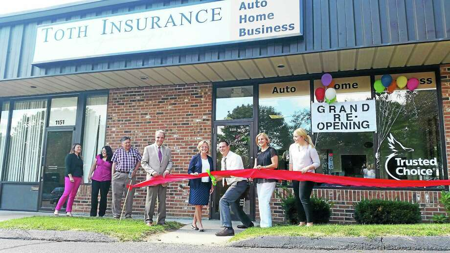 Members of Toth Insurance Agency celebrated the company's grand reopening on Friday. The new location of the business is 1151 East Main St. Photo: Amanda Webster — The Register Citizen