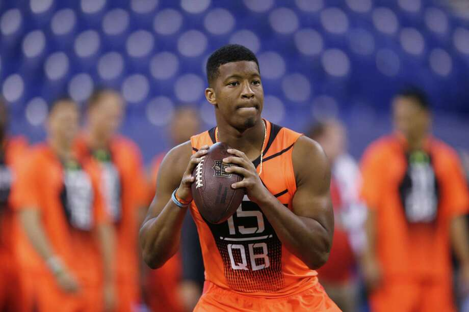 In this Feb. 21 file photo, Florida State quarterback Jameis Winston runs a drill at the combine in Indianapolis. Photo: Julio Cortez — The Associated Press File Photo  / AP