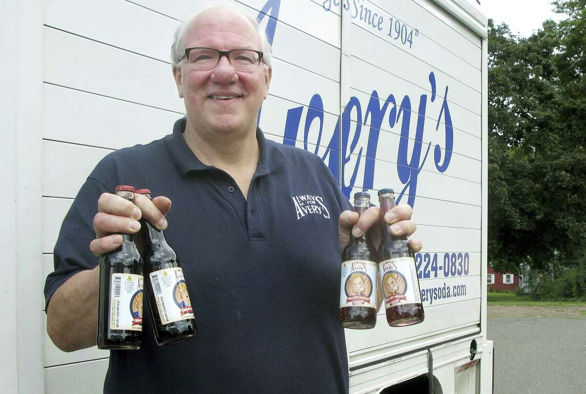Rob Metz, general manager of Avery's Beverages, holds samples of the company's latest specialty sodas, Hillary Hooch and Trump Tonic, outside the Avery's bottling facility Monday in New Britain. This is the third presidential race for which the company created candidate-based sodas and held a straw poll based on sales. During the last two cycles, Barack O'Berry beat John McCream and Cream de Mitt.