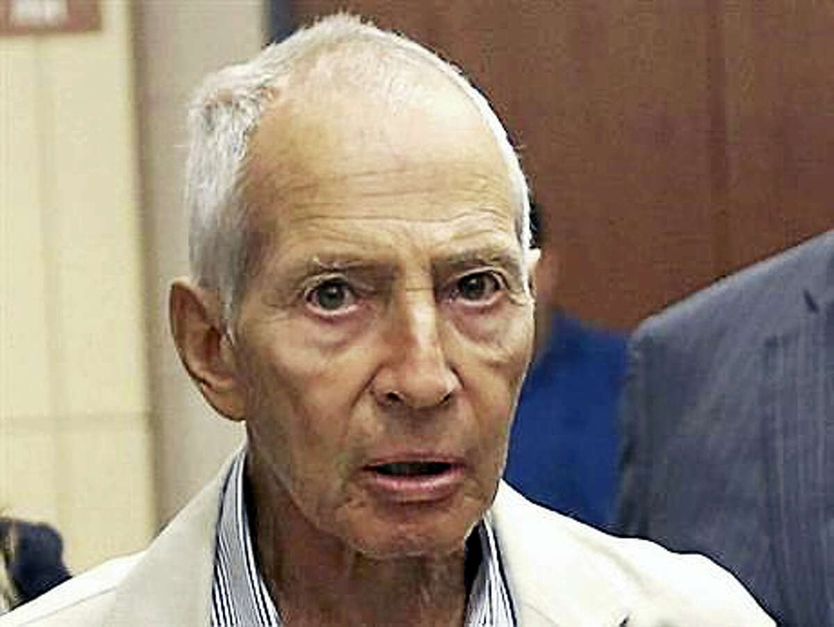 n this Aug. 15, 2014, file photo, New York City real estate heir Robert Durst leaves a Houston courtroom. New Orleans Federal Judge Kurt Engelhardt on Wednesday, April 27, 2016, approved a plea agreement for Durst to serve 7 years and 1 month in prison on a weapons charge. Durst still faces a separate murder charge in California.