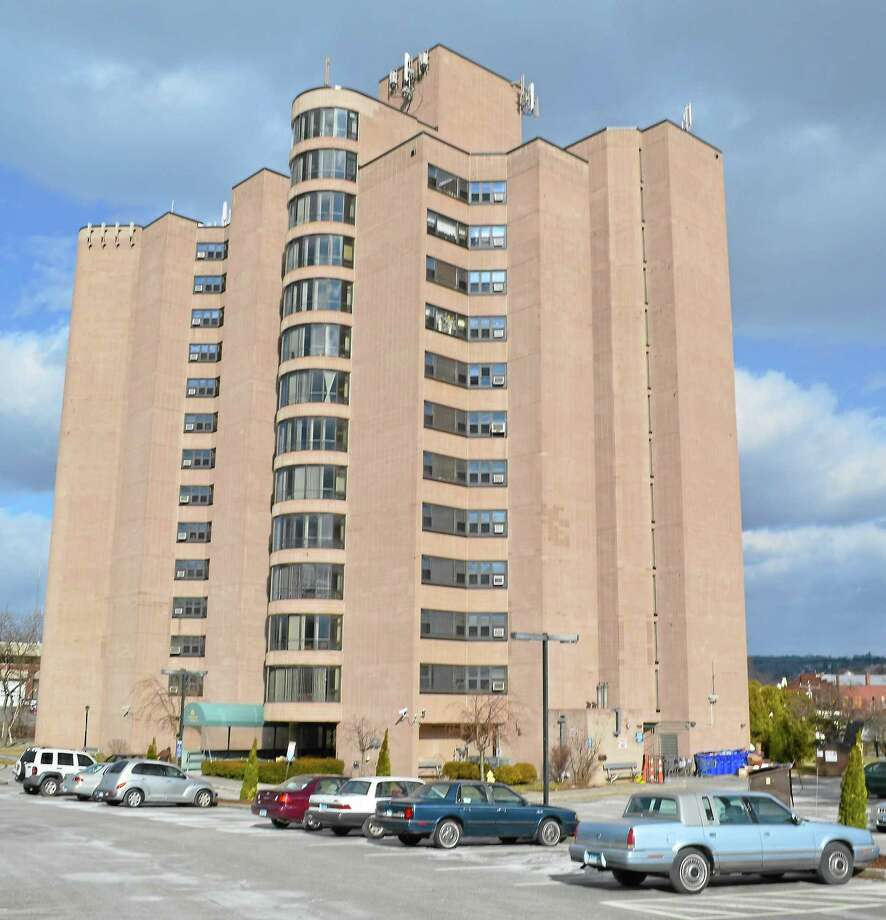 Torrington Towers on Summer Street, a public housing building that is home to mainly elderly residents, has been a trouble spot in the past for police. But recent statistics show a different story. Photo: Journal Register Co.
