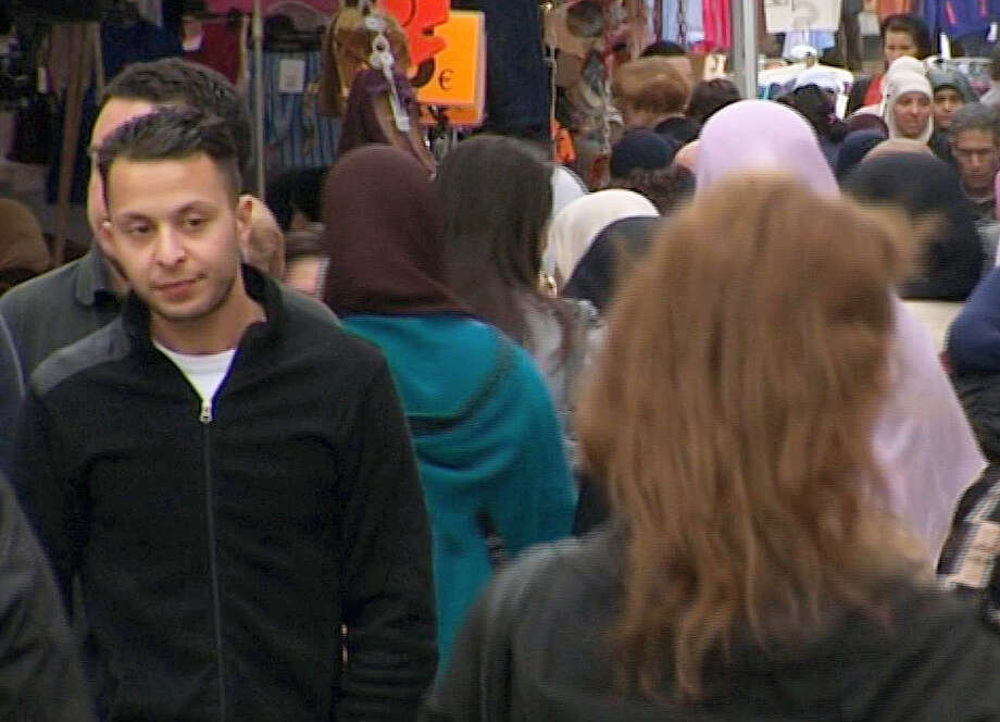 This Wednesday, April 13, 2016 file image taken from video of Salah Abdeslam, left, the fugitive from the Nov. 13 Paris attacks whose capture appears to have precipitated the March 22 bombing in Brussels. Belgian prosecutors confirmed Wednesday April 27, 2016 that Paris attacks suspect Salah Abdeslam was handed over to French authorities. Photo: TVbrussels Via AP   / Tvbrussels