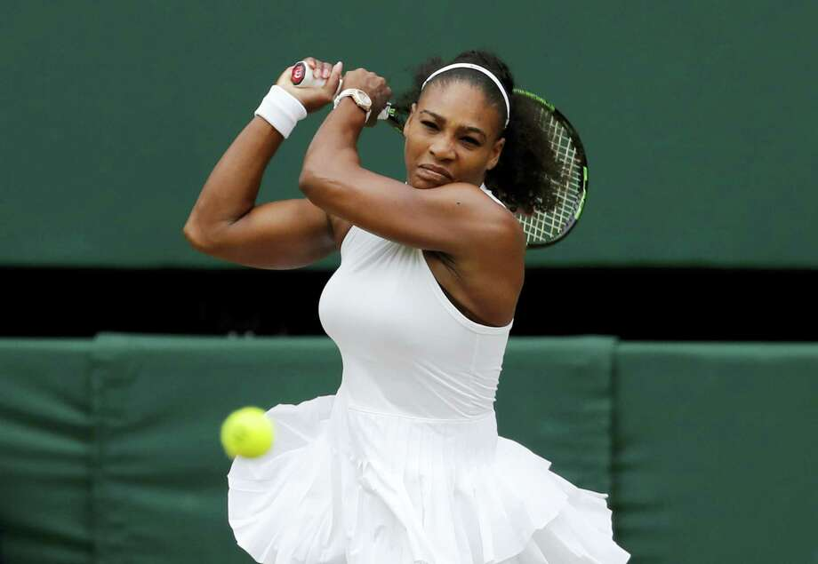 AP Photo/Ben Curtis Serena Williams of the U.S returns to Angelique Kerber of Germany during their women's singles final on day thirteen of the Wimbledon Tennis Championships in London on July 9, 2016. Photo: AP / Copyright 2016 The Associated Press. All rights reserved. This material may not be published, broadcast, rewritten or redistribu