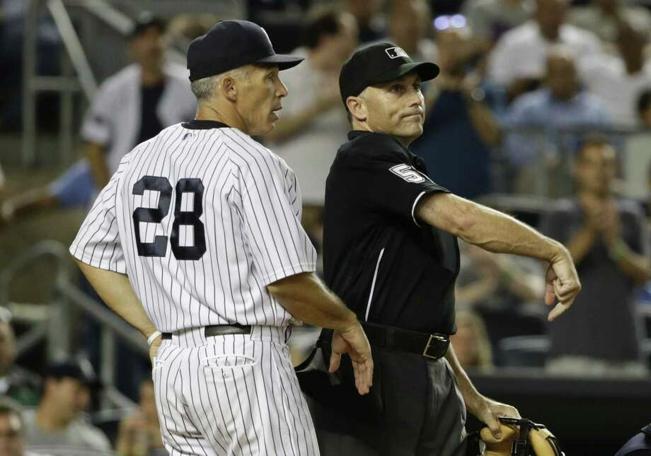 Home plate umpire Dan Iassogna ejects New York Yankees manager Joe Girardi during the ninth inning of the Yankees' baseball game against the Cleveland Indians, Thursday, Aug. 20, 2015, in New York. The Indians won 3-2. (AP Photo/Frank Franklin II) Photo: AP / AP