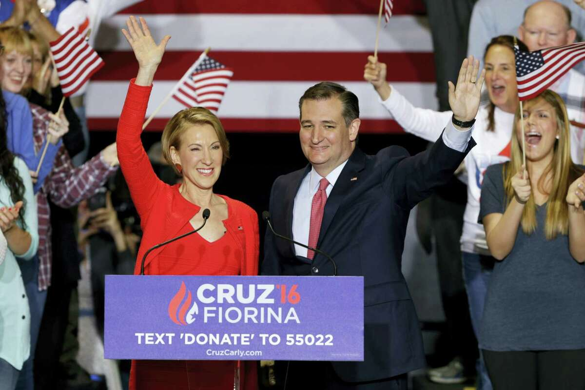 Republican presidential candidate Sen. Ted Cruz, R-Texas, joined by former Hewlett-Packard CEO Carly Fiorina waves during a rally in Indianapolis, Wednesday, April 27, 2016, when Cruz announced he has tapped Fiorina to serve as his running mate.