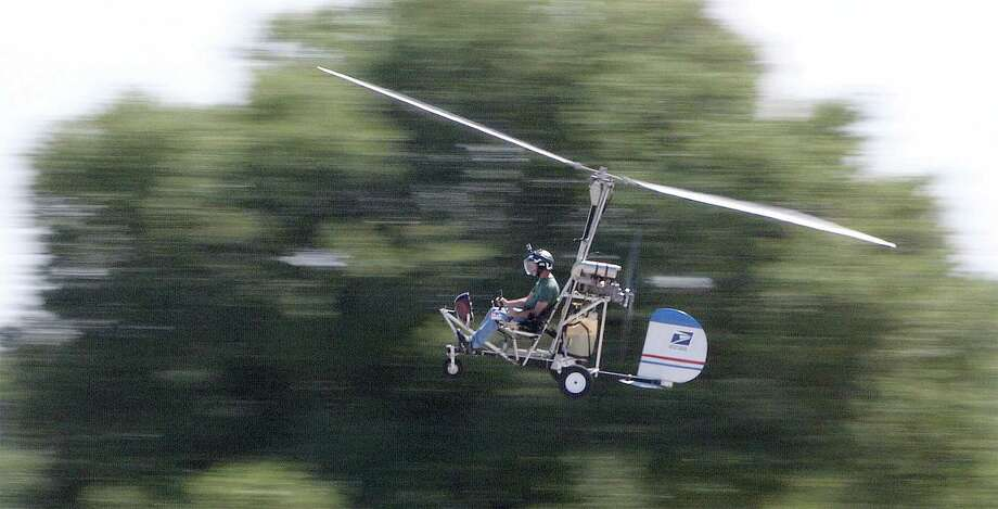 In this March, 2015, photo, Doug Hughes flies his gyrocopter near the Wauchula Municipal Airport in Wauchula, Fla. Police didn't immediately identify the man who steered his one-person helicopter onto the West Lawn of the U.S. Capitol, but Hughes, a Florida postal carrier, took responsibility for the stunt on a website. (James Borchuck/The Tampa Bay Times via AP) Photo: AP / Tampa Bay Times