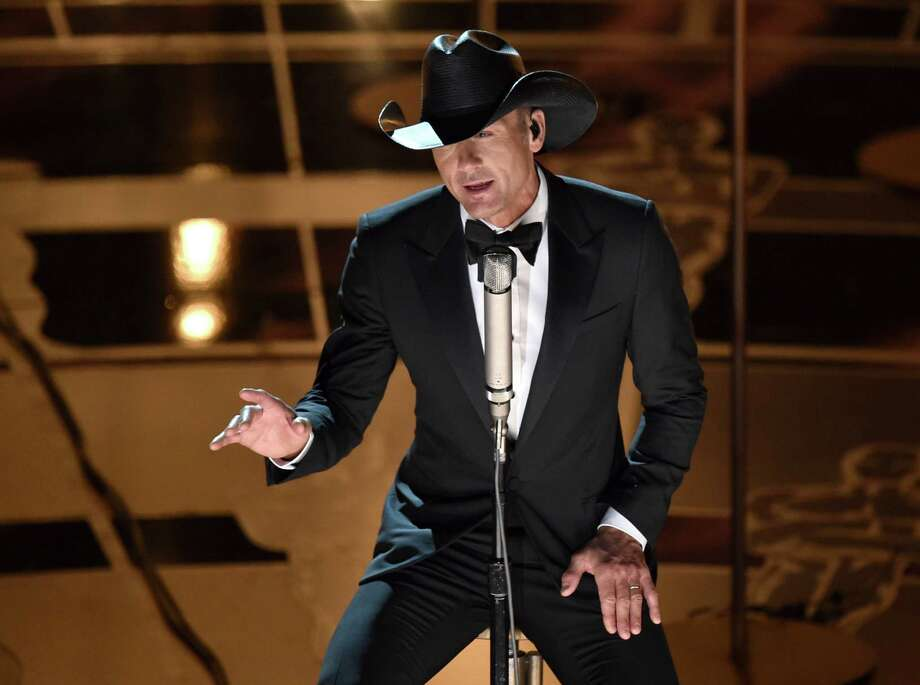 In this Feb. 22, 2015 photo, Tim McGraw performs at the Oscars at the Dolby Theatre in Los Angeles. McGraw will hold a concert for Sandy Hook this summer and dedicate all of the proceeds to an organization aimed at protecting children from gun violence. He will perform at the XFINITY Theatre in Hartford, Connecticut on July 17. Photo: Photo By John Shearer/Invision/AP, File  / Invision