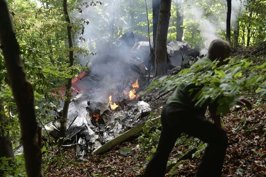 The burning debries of a light aircraft photographed near the village of Cerveny Kamen, Slovakia on Aug. 20, 2015. Two planes carrying dozens of parachutists collided in midair over western Slovakia, killing several people, officials said. Photo: Radovan Stoklasa /TASR Via AP  / TASR