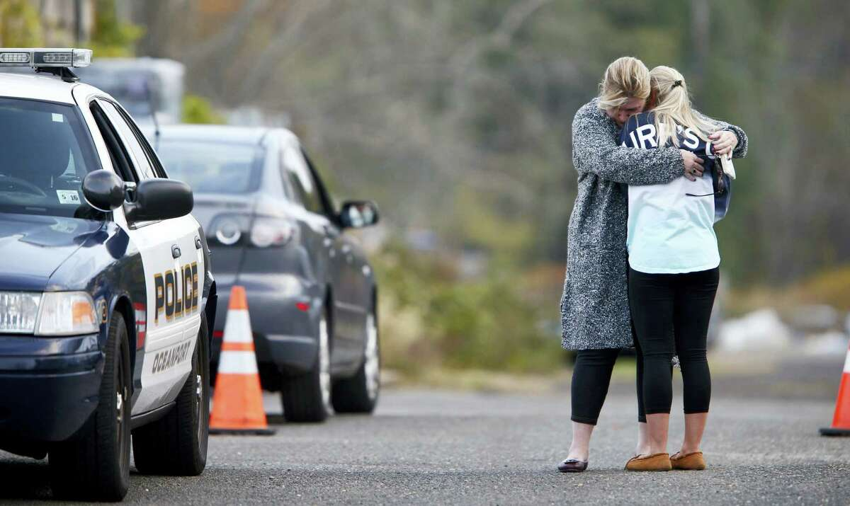 A woman, who police identified as a friend of the victim, is consoled by another woman on the long driveway that leads to the rear of the Froggia Florist and Greenhouses in Oceanport, N.J, where the body of Joseph Comunale, a missing Hofstra University graduate originally from Connecticut, was reportedly found Wednesday, Nov. 16, 2016.