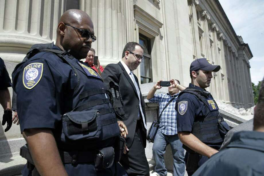 Former Subway pitchman Jared Fogle leaves the Federal Courthouse in Indianapolis on Aug. 19, 2015 following a hearing on child-pornography charges. Fogle agreed to plead guilty to allegations that he paid for sex acts with minors and received child pornography in a case that destroyed his career at the sandwich-shop chain and could send him to prison for more than a decade. Photo: AP Photo/AJ Mast  / FR123854 AP