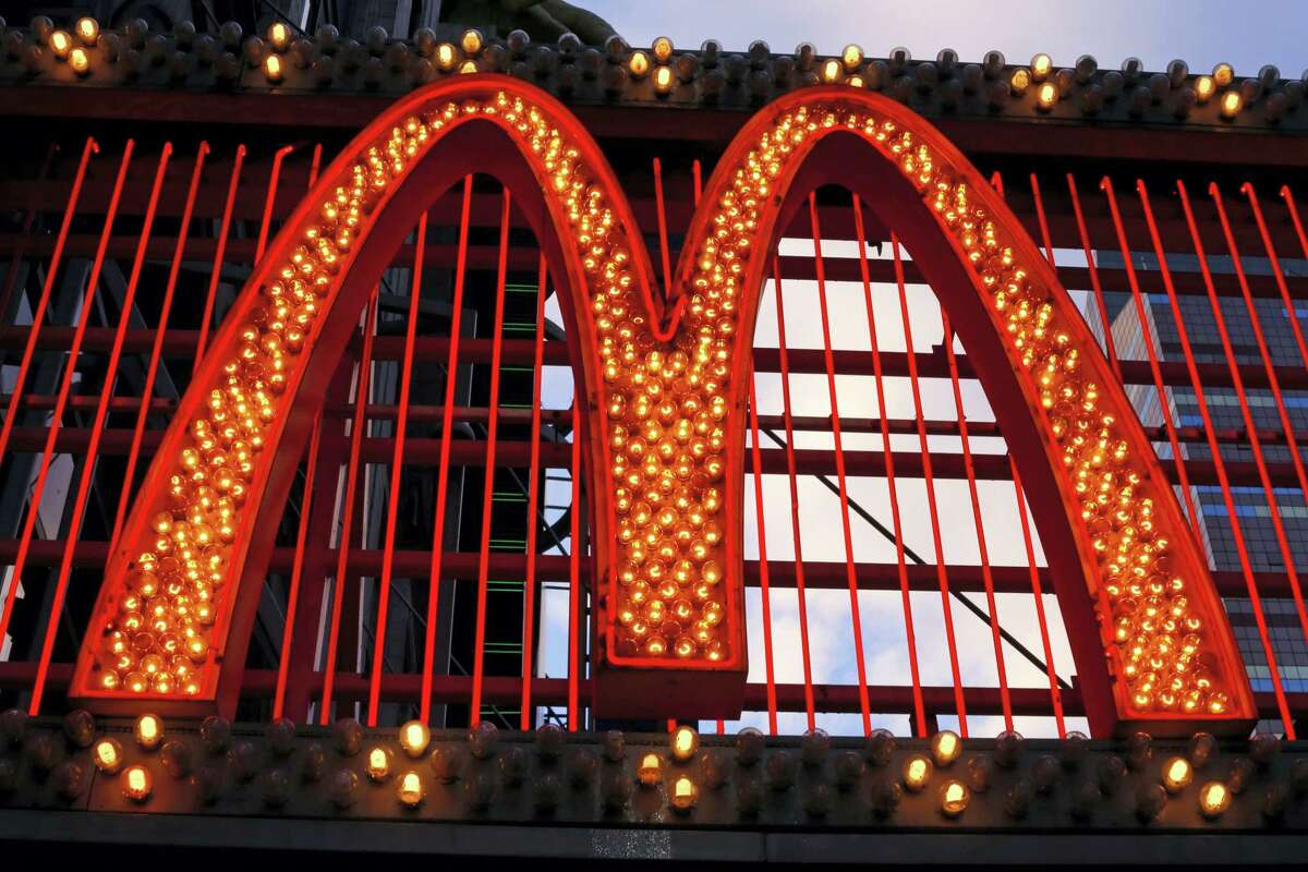AP Photo/Gene J. Puskar This Jan. 10, 2016 photo shows the sign on the McDonald's on 42nd Street near Times Square in New York.