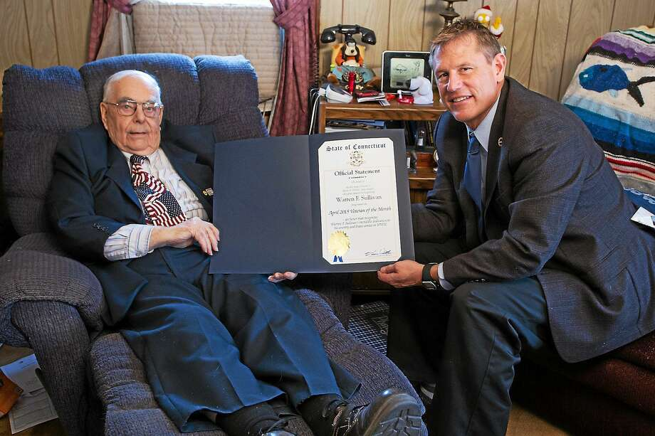 Senator Witkos presents Warren Sullivan Sr. with a citation recognizing him as the April 2015 Veteran of the Month. Witkos met with Sullivan in his home in Winsted to record a special interview about his life in the Navy. Photo: Contributed Photos  / All Rights Reserved