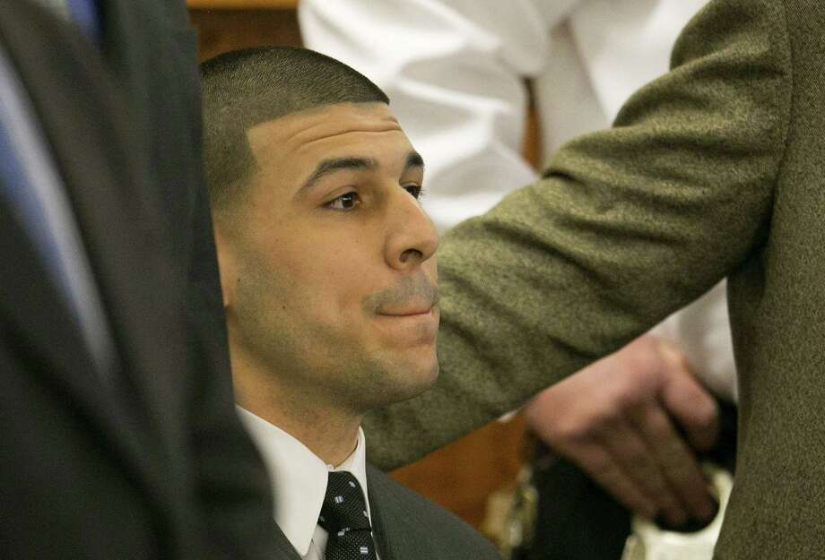 Former New England Patriot Aaron Hernandez listens as the guilty verdict is read during his murder trial on Wednesday at Bristol County Superior Court in Fall River, Mass. Photo: Dominick Reuter — The Associated Press  / Pool Reuters