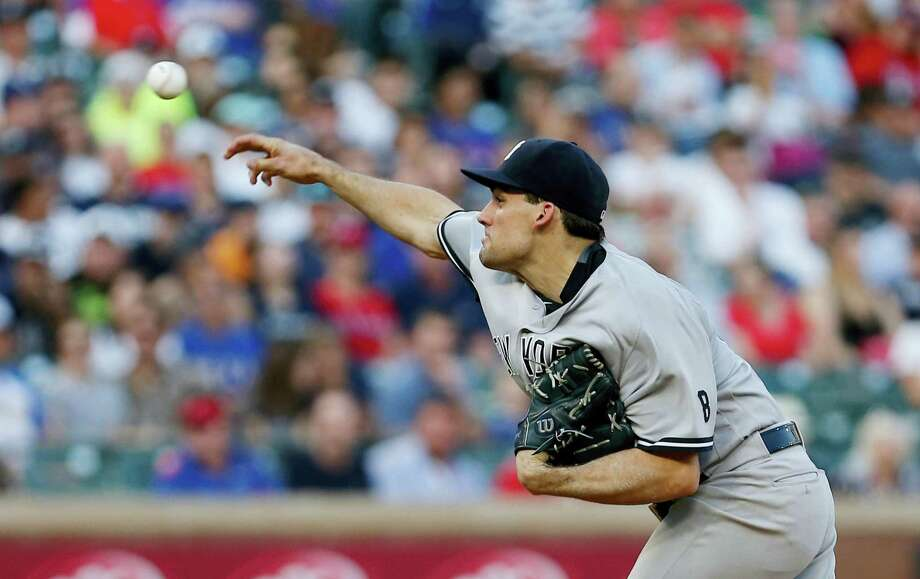 New York Yankees starting pitcher Nathan Eovaldi (30) throws during the first inning of a baseball game against the Texas Rangers on Monday, April 25, 2016, in Arlington, Texas. (AP Photo/Brandon Wade) Photo: AP / FR168019 AP