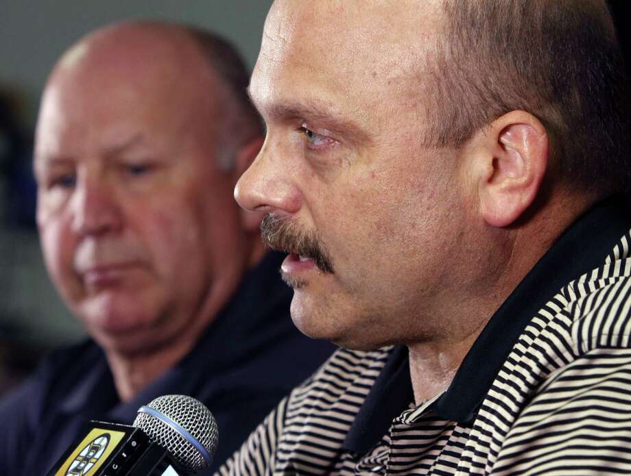 Former Boston Bruins general manager Peter Chiarelli, right, speaks alongside head coach Claude Julien at a news conference at TD Garden on Monday in Boston. Photo: Bill Sikes — The Associated Press  / AP