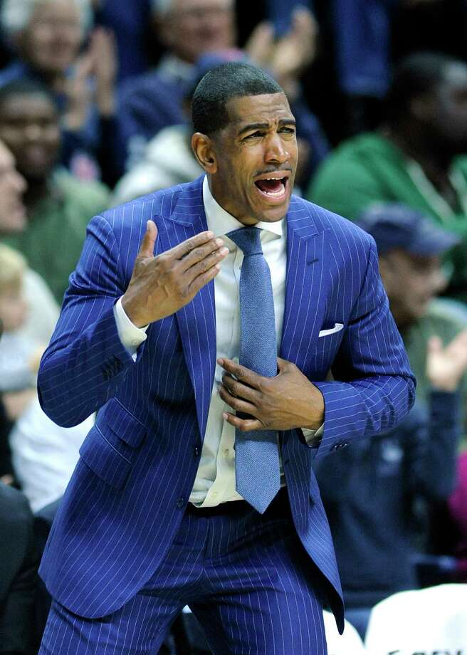 UConn head coach Kevin Ollie reacts during the second half of his team's 75-55 victory over Ohio State on Saturday. Photo: Fred Beckham — The Associated Press  / FR153656 AP