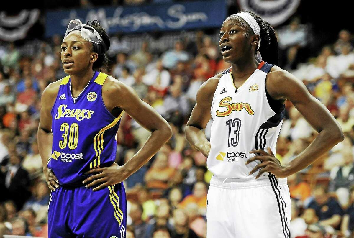 Los Angeles Sparksí Nneka Ogwumike, left, stands with her sister Chiney Ogwumike of the Connecticut Sun, during the first half of a July 13, 2014 game when the two No. 1 picks in the WNBA squared off for the first time as pros. Chiney Ogwmike returned to Sun training camp on Monday.