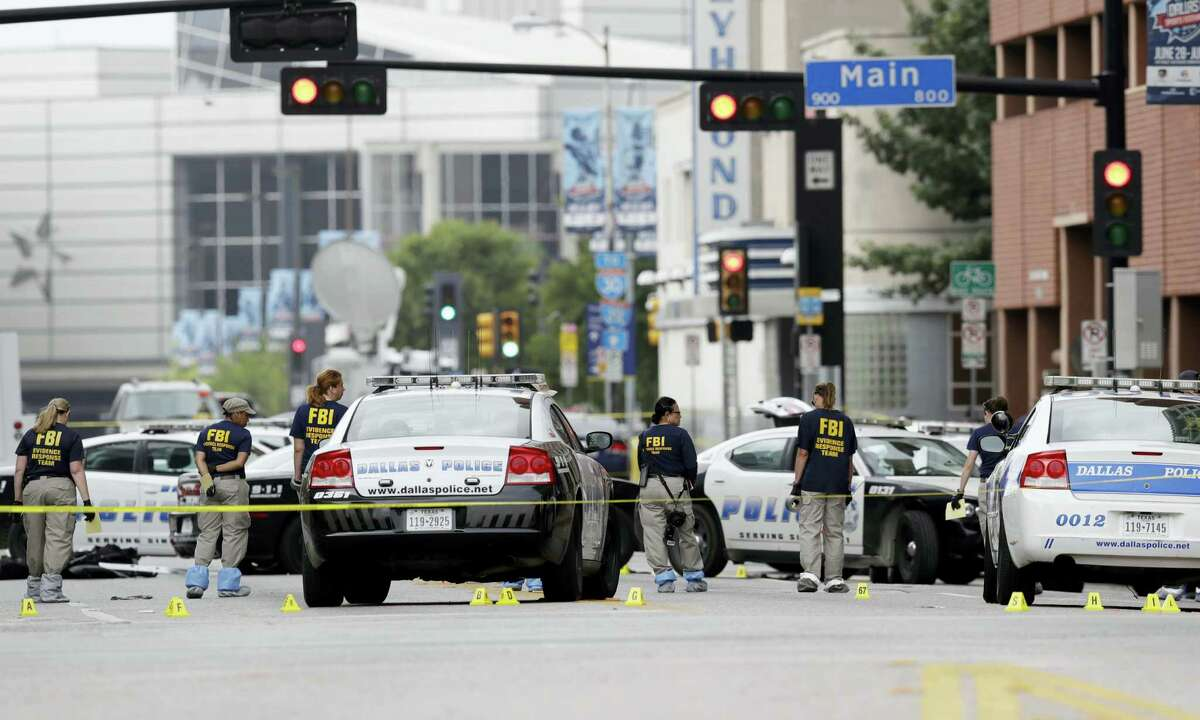Investigators work in the area of downtown Dallas that remains an active crime scene on July 9, 2016. Micah Johnson, an Army veteran, opened fire on police officers in the heart of Dallas Thursday, July 7, 2016 as hundreds of people were gathered to protest two recent fatal police shootings of black men, Philando Castile and Alton Sterling.