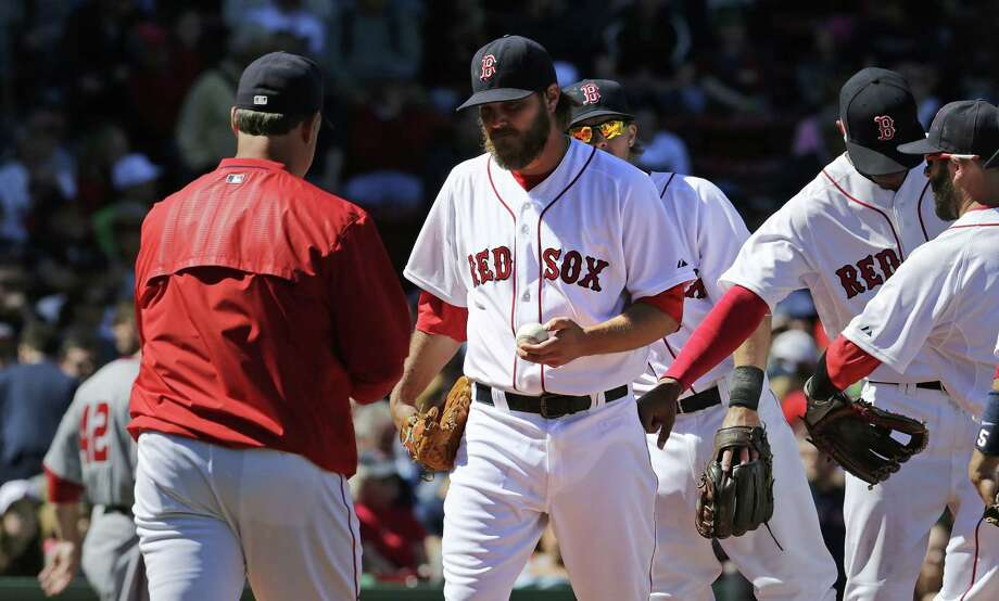 Red Sox starter Wade Miley hands the ball to manager John Farrell as he is taken out of the game after giving up a three-run double to Washington Nationals catcher Wilson Ramos during the third inning Wednesday at Fenway Park in Boston. Photo: Charles Krupa — The Associated Press  / AP