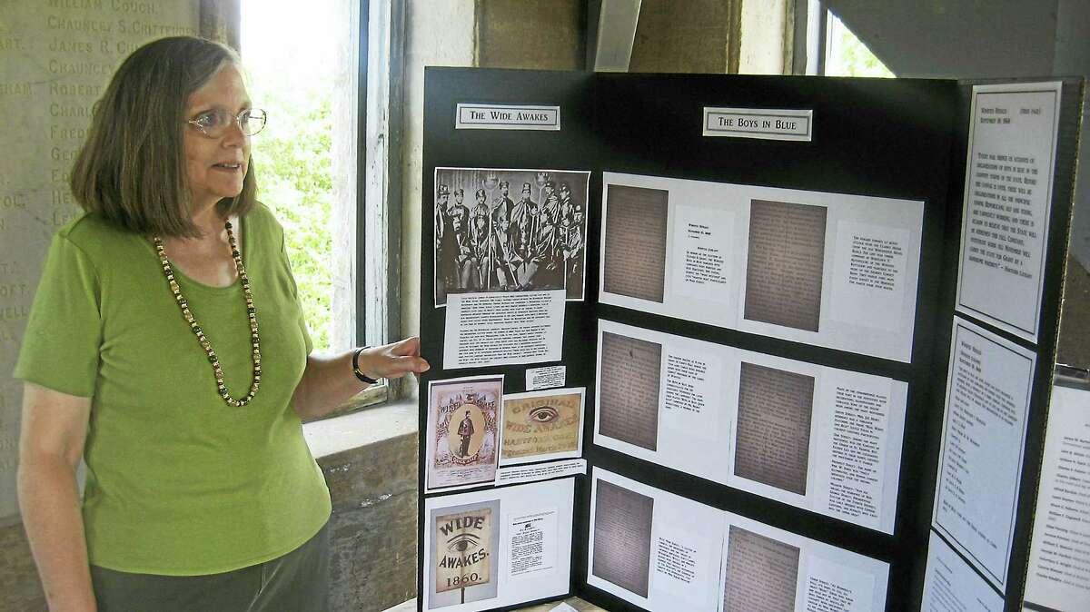 Virginia Shultz-Charette discusses a display.